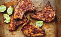 Mexican adobe on pork chops with lime on a chopping board