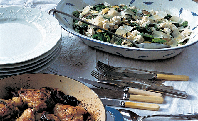 lunch with white plates pot of chicken and salad, knives and forks. Diana Henry