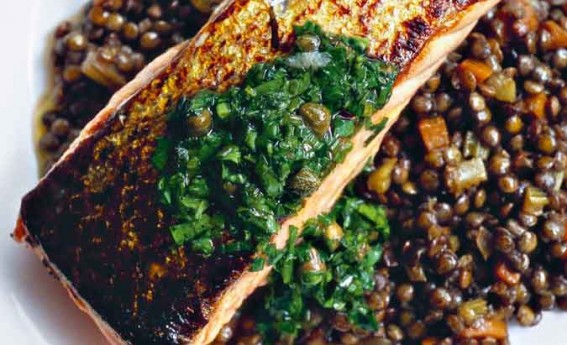 salmon on lentils with herb relish on top