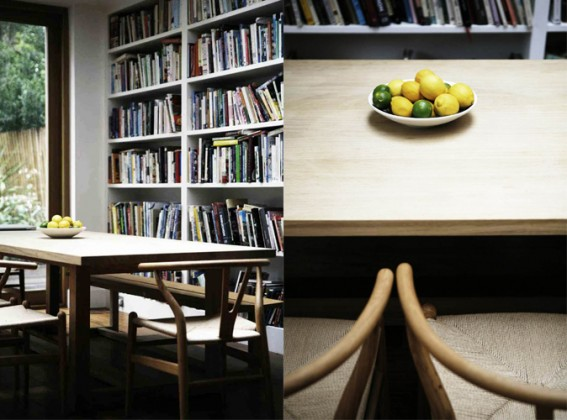 Diana Henry Kitchen table with book shelf and table with lemons and chairs.