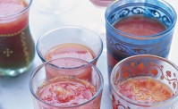 blood orange & cardamom jellies in Moroccan tea glasses on a white table cloth
