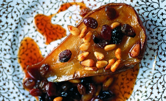 Pears, raisins and pine nuts baked in muscatel on a gold floral plate