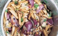penne with gorgonzola roasted red onions and walnuts with parsley in a silver pot