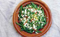 green beans with feta, and terata on a terracotta plate