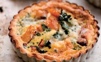 pumpkin tarts with spinach and Gorgonzola in silver pie dish