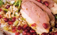 smoked duck pomegranates faro and chicory on an old fashioned flower plate