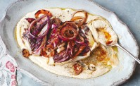 radicchio and red onion and white bean puree on a white ceramic dish.