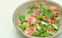 ceramic bowl with rice, edam beans, sugar snap peas and pickled ginger.