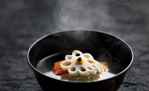 Japanese soup in black bowls and steam from Umu restaurant London.