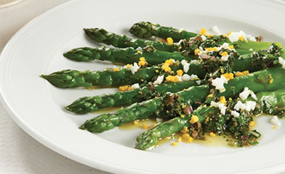 asparagus and egg with salsa on a white plate.