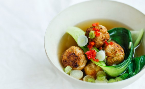 Ginger chicken balls on a white bowl.