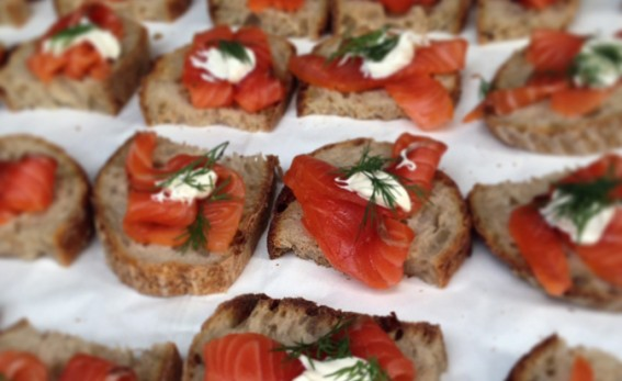 smoked salmon on rye with creme fraiche and dill.
